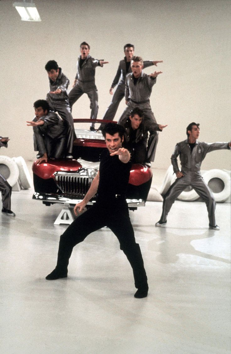 grease movie Grease is the one that you want go back to high school with pink lady sandy (olivia newton-john), leader of the bad-boy t-birds, danny (john travolta), and a rockin' and rollin' all-star cast.